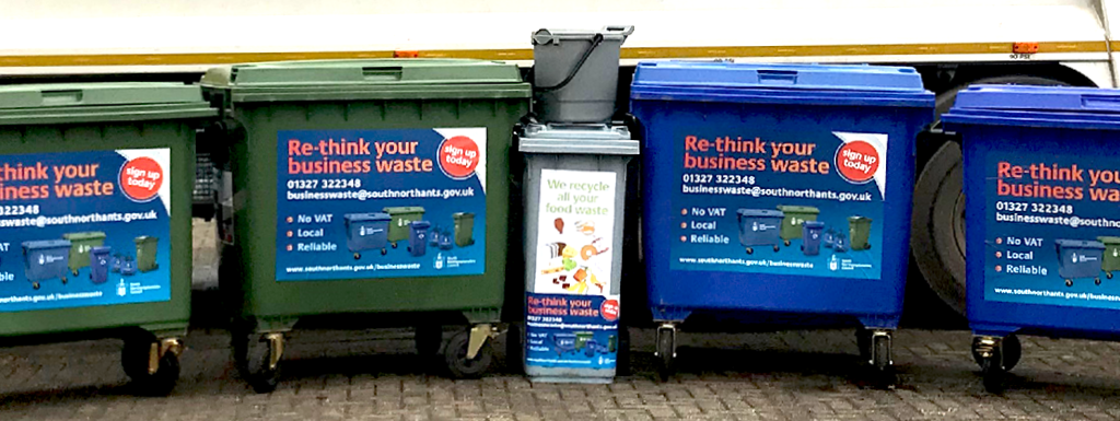 Blue and Green waste bins in a row