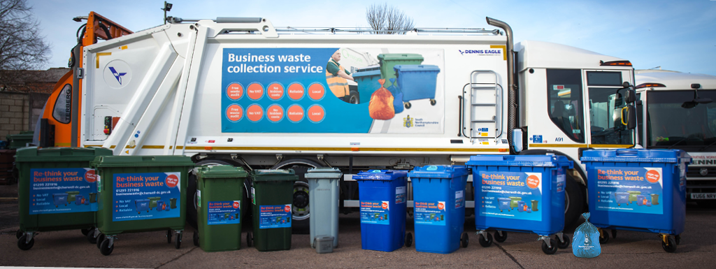 Bin lorry with bins of all types and sizes lined up in front