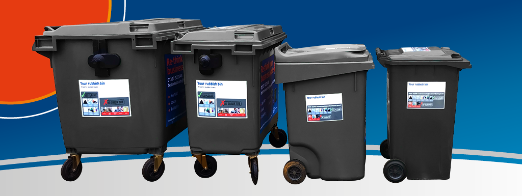 Black waste bins lined up in size